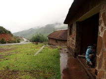 Cooking lunch under the rain, Lesotho