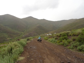 Riding a dirt road in the rain, Lesotho